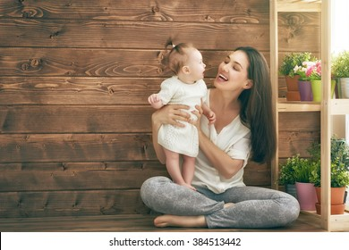 Happy loving family. Mother and her child baby girl playing in the summer day.