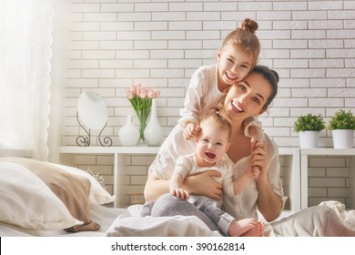 1312956 Mother And Mother And Child Images Royalty Free Stock