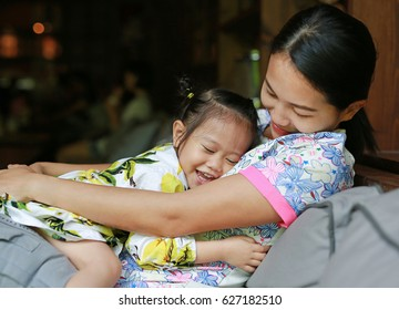 Happy loving family. mother hugging her child on sofa.
