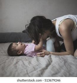 happy loving family. mother playing with her baby in the bedroom. Cozy house, lifestyle, selective focus, toning