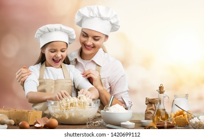 Happy loving family are preparing bakery together