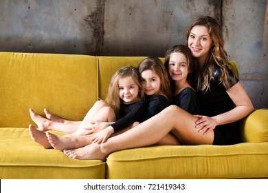 happy loving family. pretty young mother plaing with her daughters