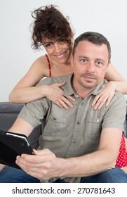 Happy loving man and woman sitting in living room