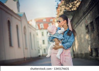 Happy loving mother and her baby outdoors. First vacation time together.