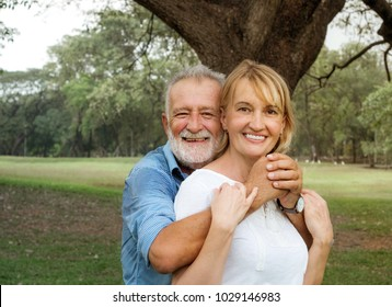 Happy loving senior couple together in a summer park, Happy life, Romantic Moment