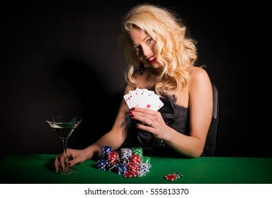 Happy and lucky woman playing poker