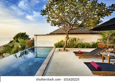 Happy in luxury villa  garden for relaxing in spa resort & hotel. In front of the house is a beach view. You can sleep on the bed and see sunrise or sunset from the sea. Behind is a small garden.