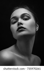 happy luxury woman model with professional makeup on black background, monochrome