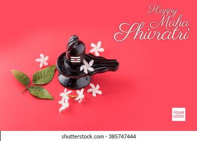 Happy Maha Shivaratri greeting card -  Shiva Linga decorated with flowers & bel patra/leaf and haldi kumkum for Pooja/worshipping of Shankar bhagwan.