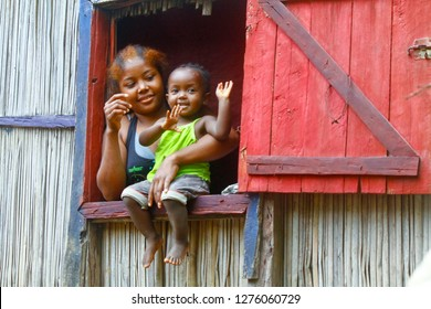 Happy malagasy woman with her child