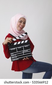 happy malay with red tudung holding clapper board