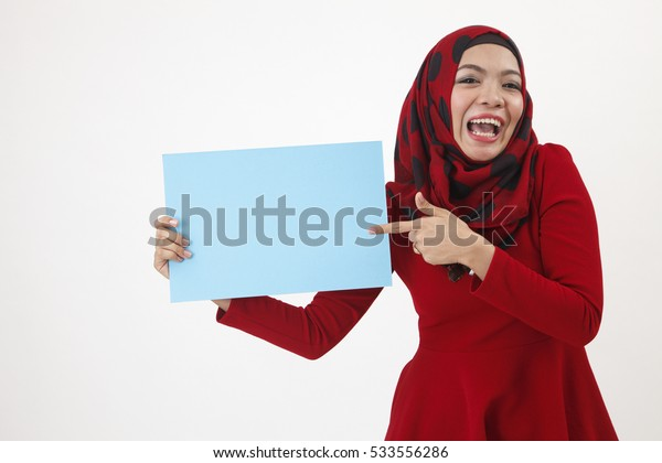 happy malay woman point to the card that she holded