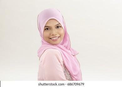 Happy malay woman with tudung looking at camera