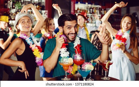Happy male 31-35 years old is having fun on hawaiian party