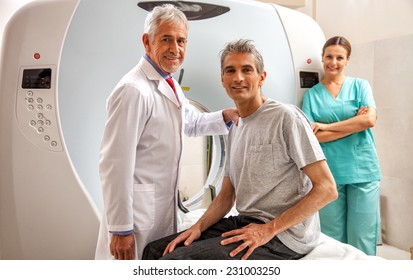 Happy male in 40s ready to undergo mri open scan with reassuring doctors. Health concept.