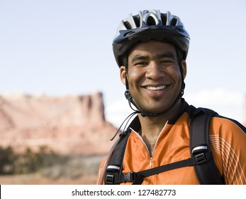 Happy male african american cyclist with helmet