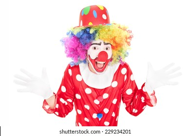 Happy male clown gesturing with hands isolated against white background