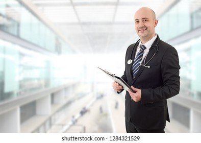 happy male doctor, at the hospital