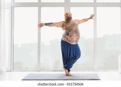 Happy male fatso enjoying morning exercise