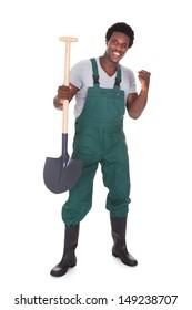 Happy Male Gardener Holding Shovel Over White Background