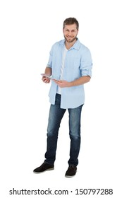 Happy male model using his tablet pc on white background