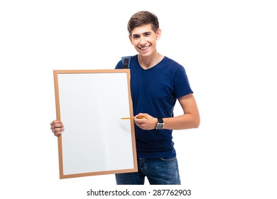 Happy male student pointing on blank board isolated on a white background. Looking at camera