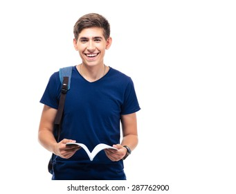 Happy male student standing and holding book isolated on a white background. Looking at camera