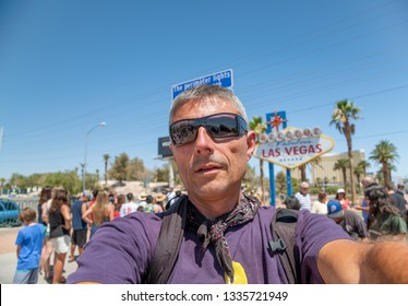 Happy male tourist making a selfie in front of famous Welcome to fabulous Las Vegas sign.