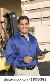 Happy male worker in the warehouse