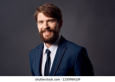 happy man with beard and mustache, blue suit