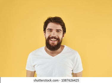 happy man with a beard, yellow background, rest