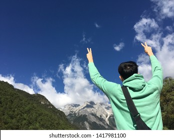 A happy man with beautiful mountain view for background.