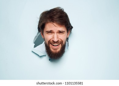 A happy man broke his head against the background