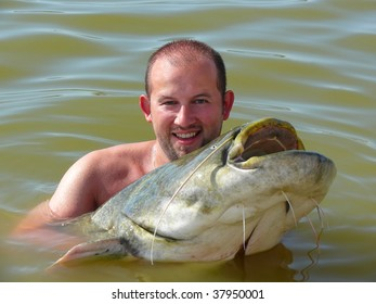 A happy man with a catfish he just caught