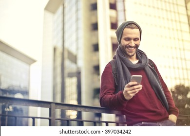 Happy man checking his phone