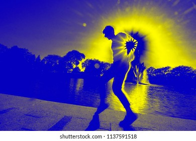Happy man Dancing, Having Fun And Enjoying Party Outdoors.  Summer Weekend. High Resolution. Artistic dancing image with surreal colors