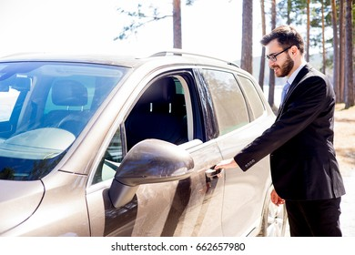 Happy man entering his car