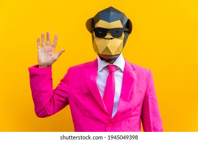 Happy man with funny low poly mask on colored background - Creative conceptual idea for advertising,adult with low-poly origami paper mask doing funny poses