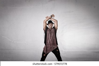 happy man gestures x with arms, light background