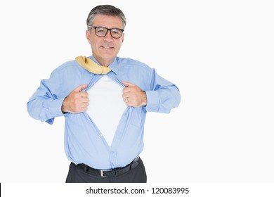 Happy man with glasses is pulling his shirt with his hands like a superhero
