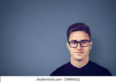 Happy man with glasses, smiling