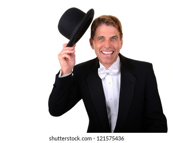 Happy man with green eyes wearing a tuxedo holding a hat isolated on white.