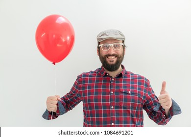 Happy man holding balloons