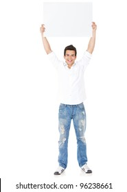 Happy man holding up a banner ad - isolated over a white background