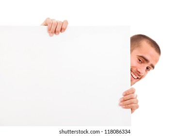 Happy man holding a blank white board