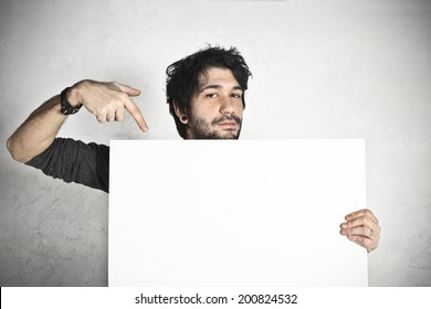 Happy man holding an empty white board