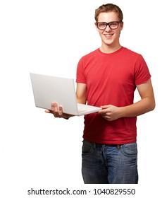 Happy man holding laptop isolated on white background