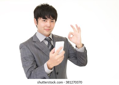 Happy man holding a smart phone