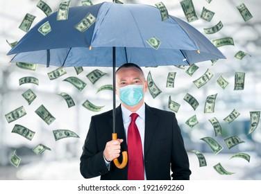 Happy man holding an umbrella in a money rain, covid coronavirus business concept