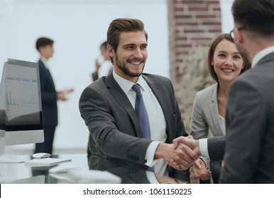 happy man introducing businesswoman to business partners
